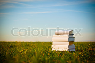 Books laying on grass