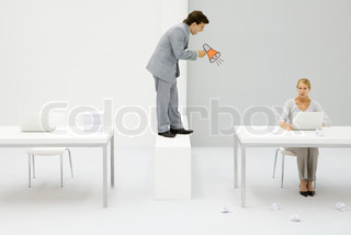 ©Ale Ventura/AltoPress/Maxppp ; Businessman shouting with megaphone at employee, woman surrounded by crumpled paper balls