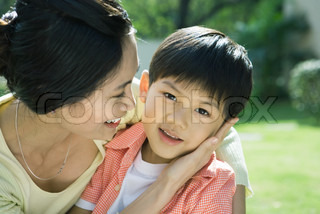 ©James Hardy/AltoPress/Maxppp ; Mother and son, woman with hand on boy's cheek, boy looking at camera