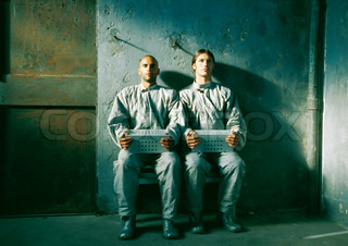 ©Frédéric Cirou/AltoPress/Maxppp ; Two men in jumpsuits sitting, holding boxes
