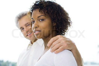 ©Laurence Mouton/AltoPress/Maxppp ; Man with arm around woman, smiling at camera, three-quarter front view