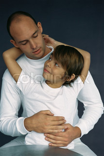 ©Laurence Mouton/AltoPress/Maxppp ; Boy sitting on father's lap, looking up at him