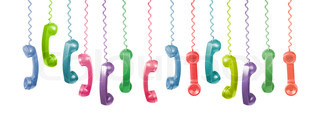 Lots of different coloured old phone handsets are hanging on white background