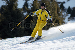 Yellow skier on ski slope