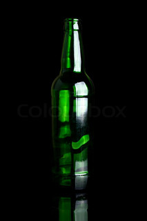green glass bottle isolated on a black background