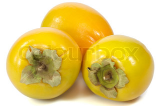 Close-up of japanese persimmon fruits over white background