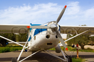 White aircraft with gray propeller