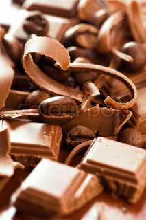 Chocolate background. Bars and strips of chocolate with coffee beans. Shallow depth of field