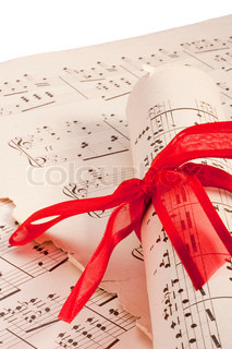Theme music, old musical notes with roll bandaged red ribbon.