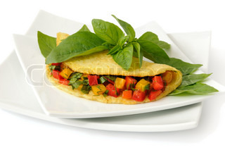 Omelette stuffed with vegetables with basil isolated