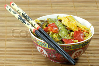 Asian food in a bowl with chopsticks