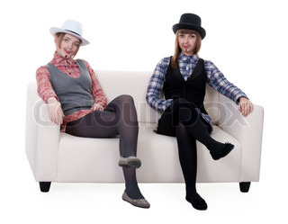 Two girls on the couch with a mustache painted on a white background