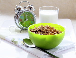 Time for breakfast Muesli in a green cup