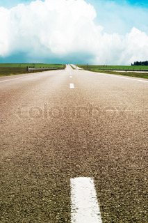 asphalt road over blue sky - travel concept