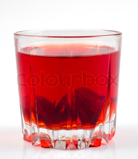 Glass of strawberry stewed fruit isolated on white