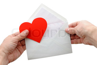 Valentine heart and envelope in hands