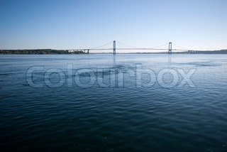 Blue water and suspension bridge from Jutland to Funen in Denmark.