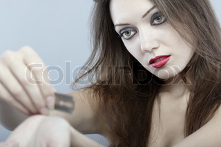 Close-up portrait of the sad lady cutting veins by razor