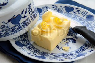 fresh yellow butter on a special plate