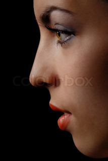 Side-view of thinking woman with red lips