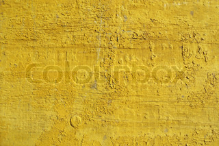 Wooden fence painted in yellow color