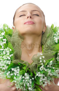 Close up portrait of naked tender spring woman covered a chaplet from the lily of the valleyc with close eyes in studio on white backgrount
