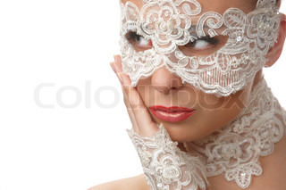 Portrait of attractive woman wearing delicate white lace on her eyes and lace necklace, lace glove, sitting of elegant position in studio, on white background
