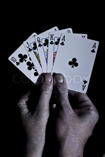 Metal men's hands with playing cards on a black background