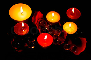 The lighted decorative candles in the dark