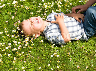 Little boy laying in the grass