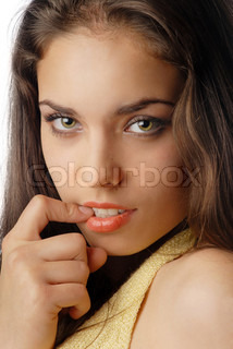 Sorrowful hesitating woman with finger in her mouth