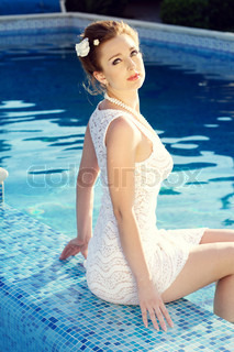 Sexy girl relaxing in a pool