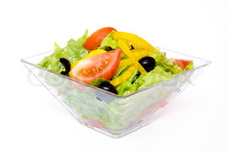 vegetable salad with lettuce, tomato, sweet peppers and olives in salad bowl isolated on white background