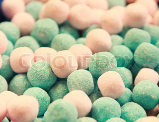 pattern of pink and blue round shaped sweets