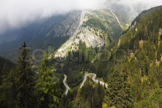 Italy, Dolomites. The magnificent mountain valley. Winding and dangerous road - the Serpentine. Photo taken by lens Fisheye