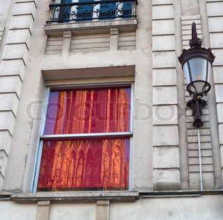 reflection of Notre Dame Cathedral in Reims (France) in windows of next house