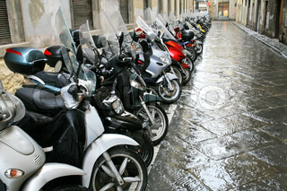 scooters parking in side street in Florence, Italy