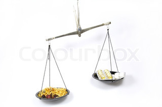 Scales symbolizing Homeopathy is more effective than traditional medicine
