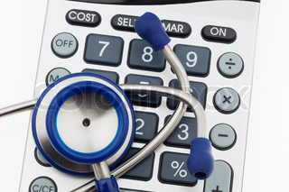 A stethoscope and a calculator. Costs of health and medicine