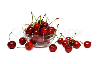 Fresh red cherry in a glass bowl isolated on a white background