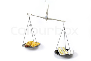 Scales symbolizing traditional medicine is more effective than Homeopathy
