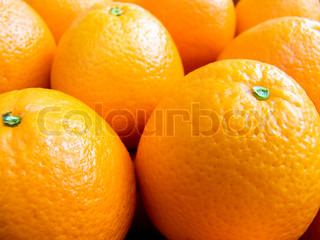 Agricultural background; a pile of beautiful oranges