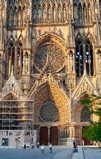 Entrance in gothic catholic Notre Dame Cathedral in Reims, France