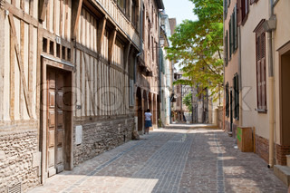 small medieval street with half-timbered houses in in Troyes, France