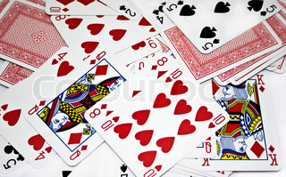 scattered pack of playing cards