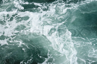 Emerald sea wave and boiling white foam