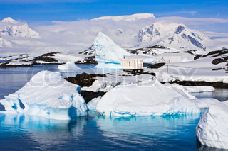 Icebergs in Antarctica, blue sky, azure water, sunny day