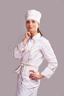 Young woman in white chef dress with hat