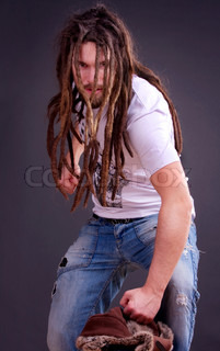 Guy with the dreadlocks fool around with a fur hat