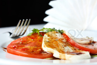Caprese salad - tomatoes, mozzarella and arugula. Traditional Italian food
